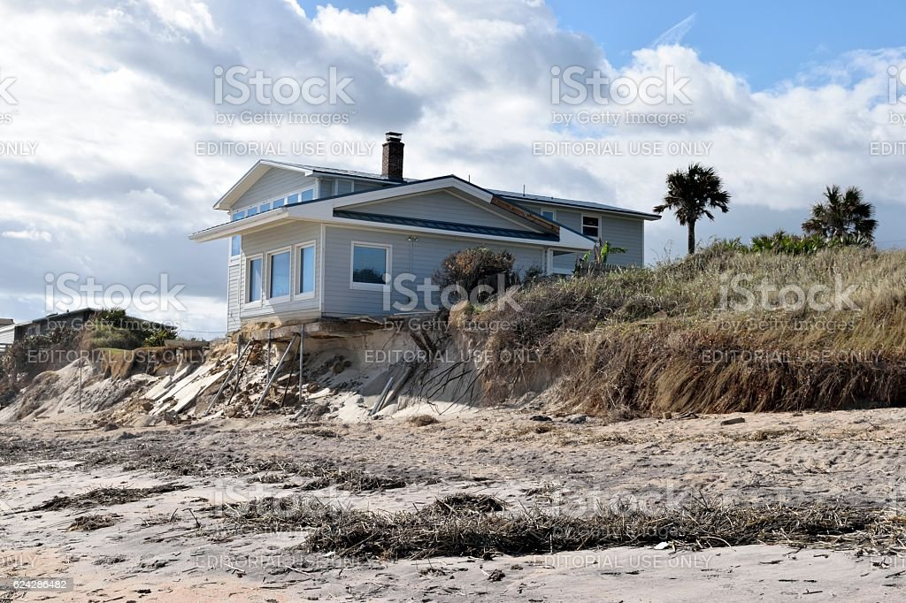 Beach Home Damage stock photo