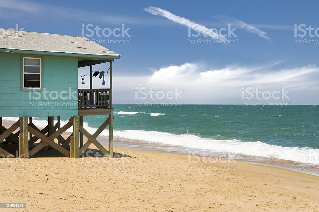 Beach House and Ocean Waves, Outer Banks, NC stock photo