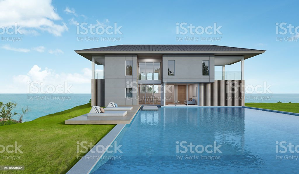 Beach house and pool with sea view in modern design stock photo