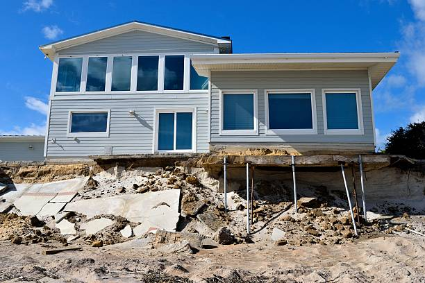 Beach House Damage Vilano Beach, Florida, USA - November 6, 2016: Aftermath of beach house damage caused by hurricane Matthew hitting the east coast of Florida on October 7, 2016. eroded stock pictures, royalty-free photos & images