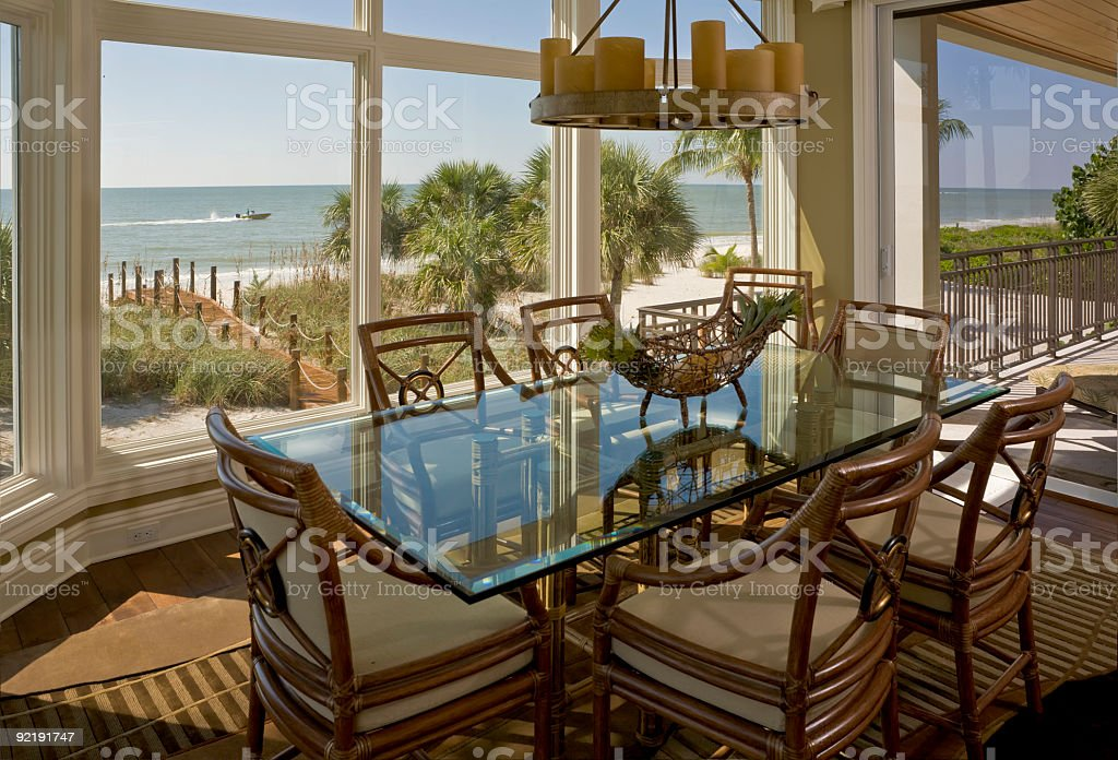 Beach House Dining Room With Beautiful View of Shore stock photo