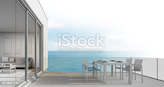 istock Beach house sketch design, Outdoor dining with sea view 612634726
