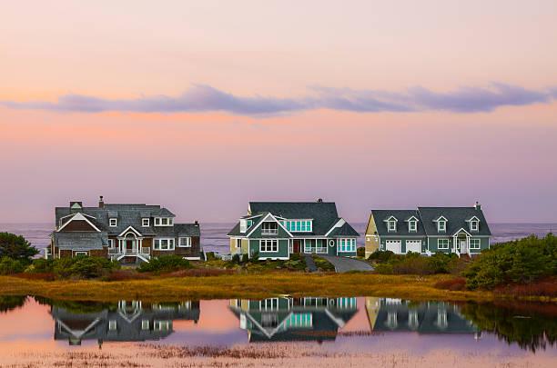beach house sunset reflections - kustlinje bildbanksfoton och bilder