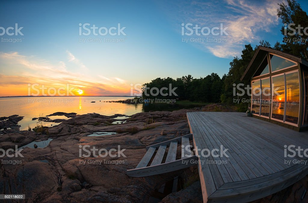 Beach house terrace at summer sunset stock photo