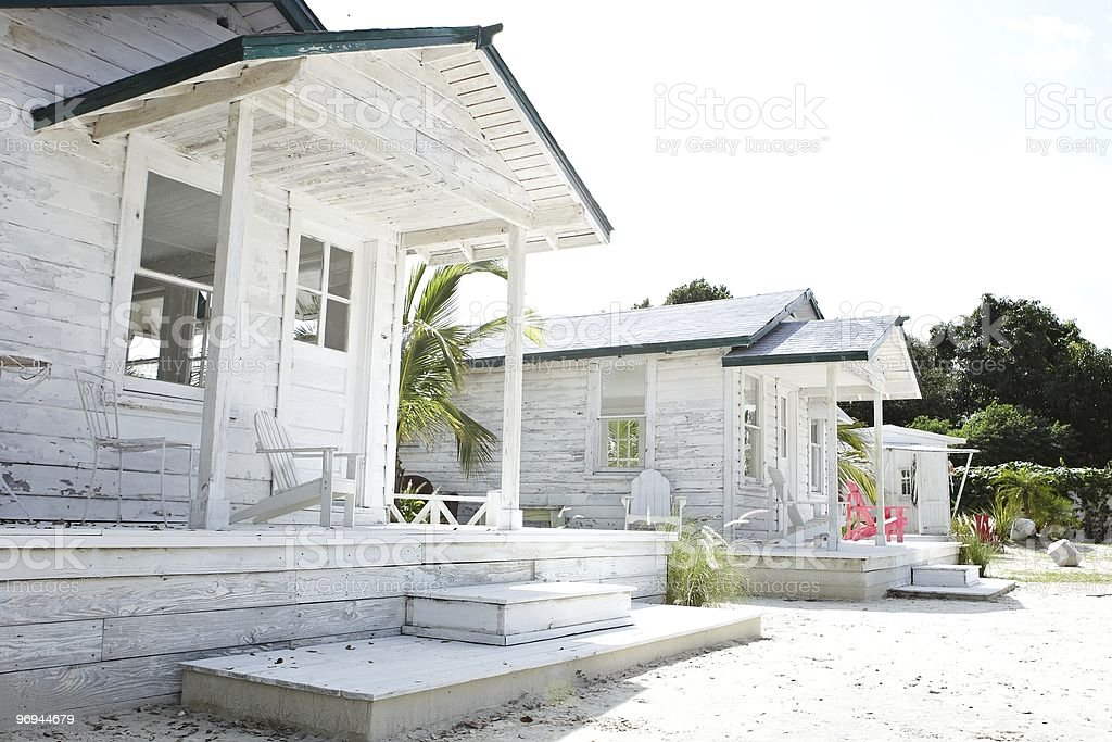 beach house with palm tree and beachchair royalty-free stock photo