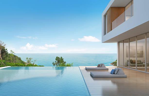 beach house with pool in modern design - modernes ferienhaus stock-fotos und bilder