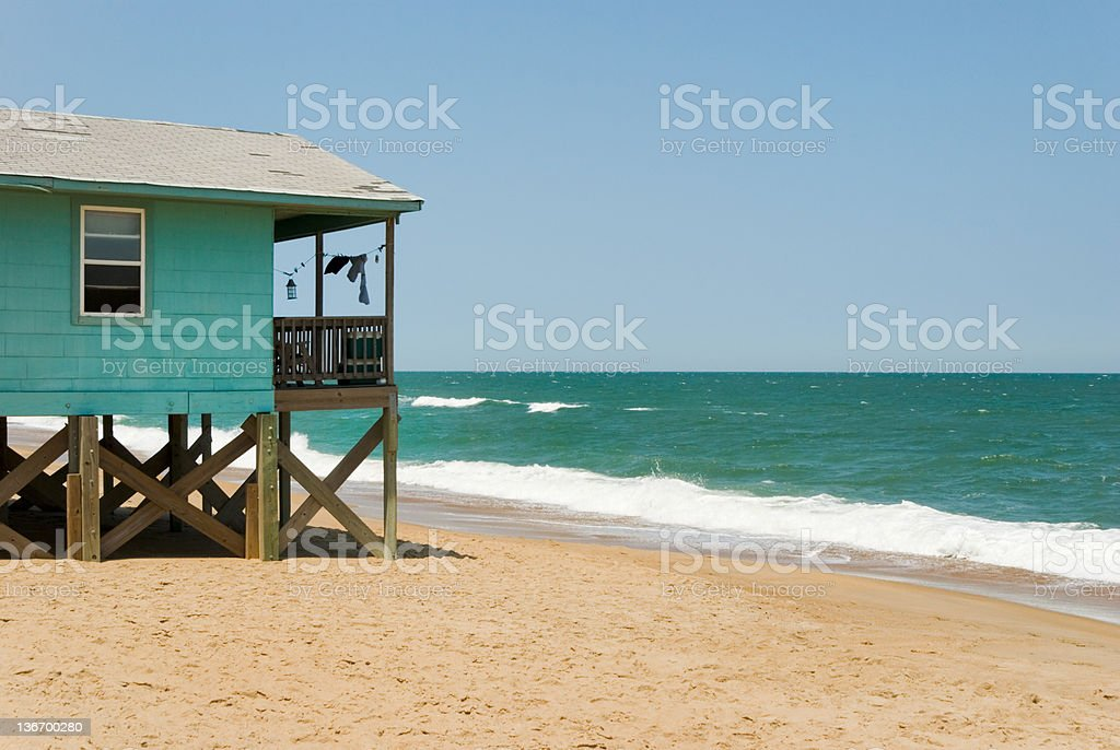 Beach House with Surf and Ocean Horizon View stock photo
