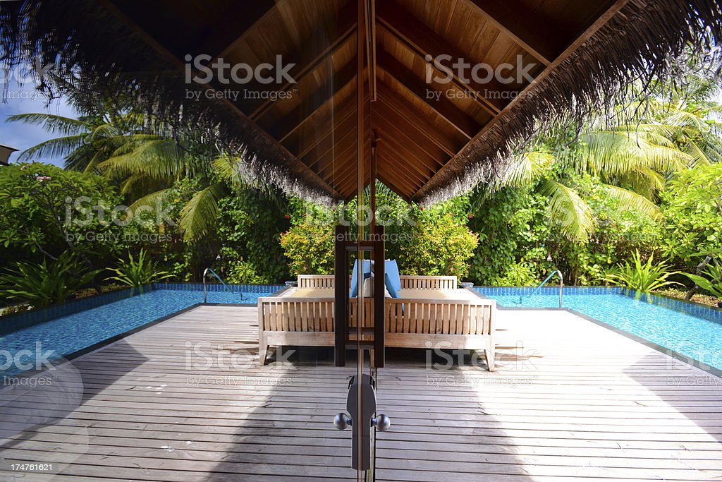 Beach House With Window Reflection royalty-free stock photo