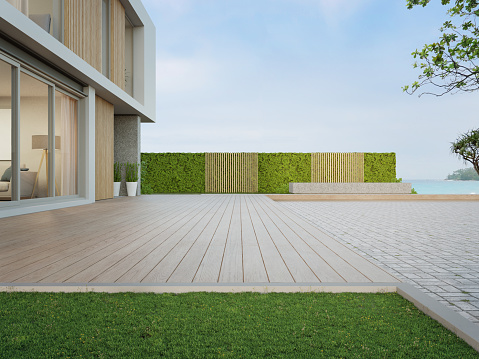 3d rendering of green grass lawn in modern sea view home.