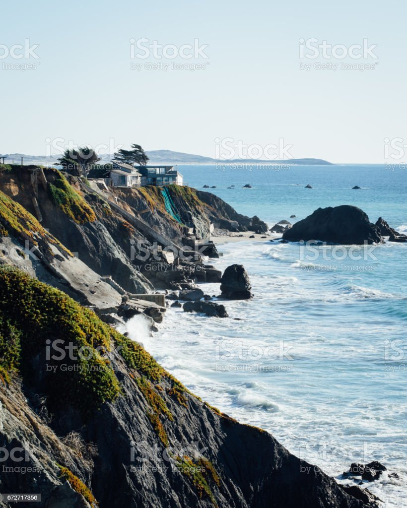 Beach Houses on a Crumbling Cliff stock photo