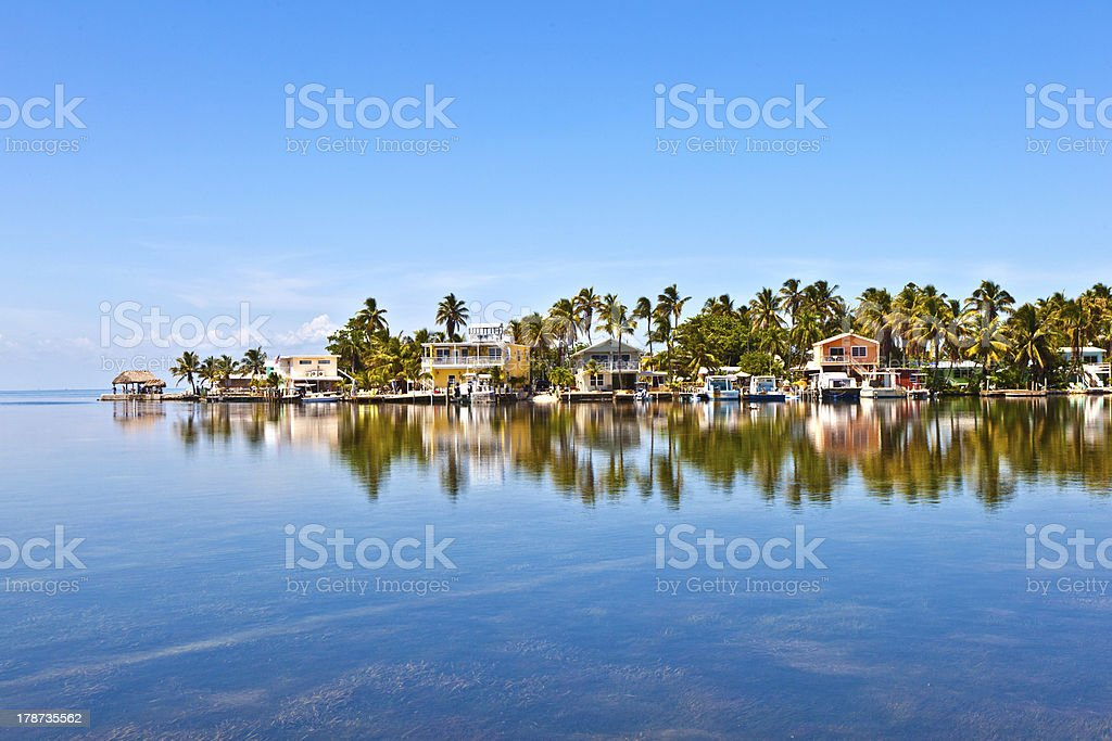 Beach houses on the waterfront in a tropical location stock photo