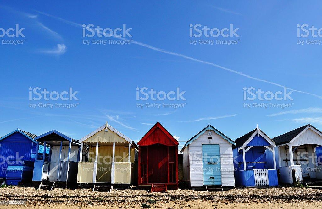Beach houses under blue sky stock photo