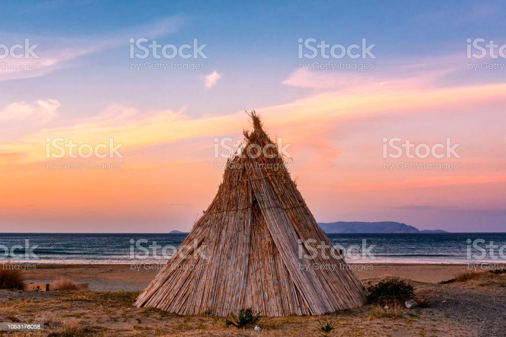 Beach hut at sunset stock photo
