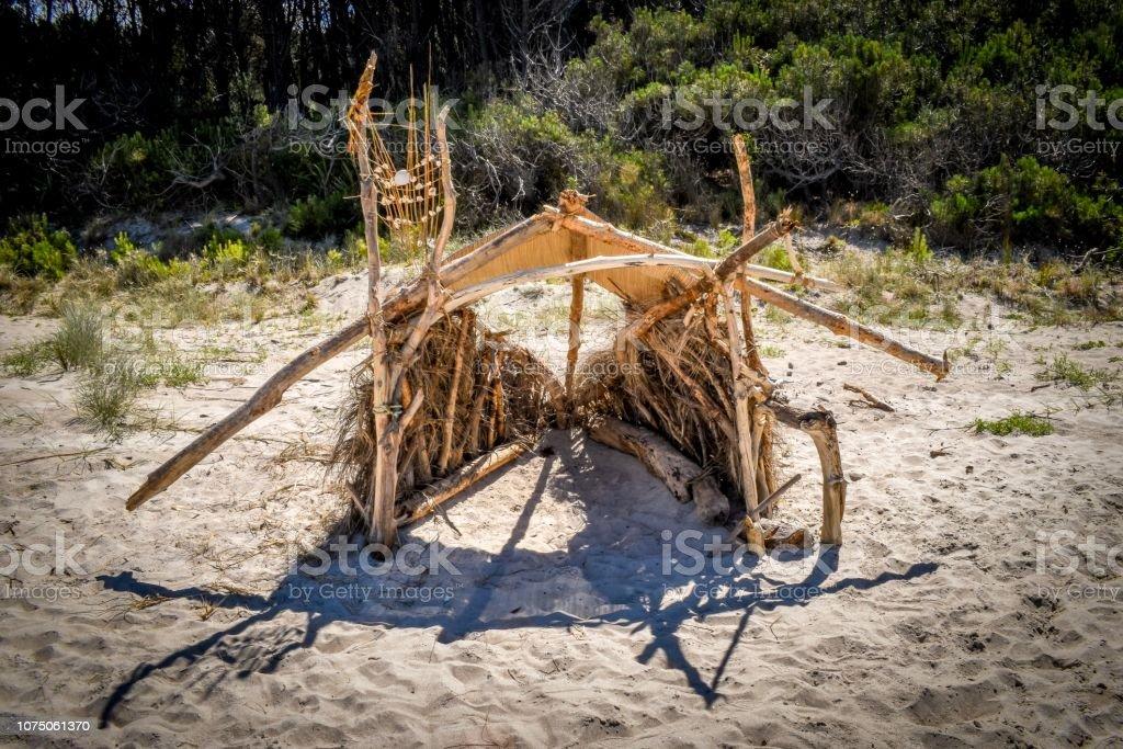 Beach hut made of drift wood on Opoutere beach New Zealand stock photo