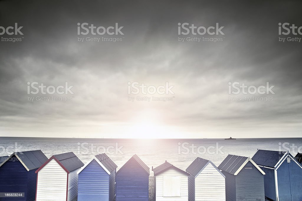 beach hut sunset stock photo