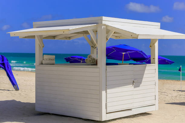 Beach hut supplying towels on sunny deserted beach stock photo
