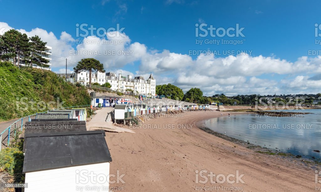 Beach huts and red sandy beach in Torquay, Devon stock photo