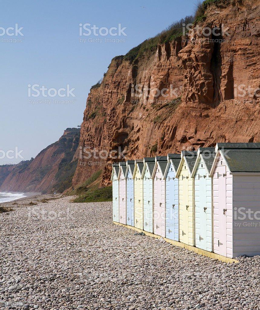 Beach huts and sandstone cliffs Budleigh Salterton Devon stock photo