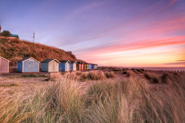 Beach huts early in the morning Beach huts early in the morning beach hut stock pictures, royalty-free photos & images