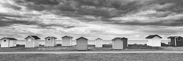 Beach huts in a row at swedish beach stock photo