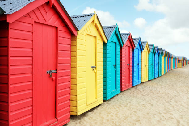Beach huts or bathing boxes on the beach Beach huts or colorful bathing boxes on the beach beach hut stock pictures, royalty-free photos & images