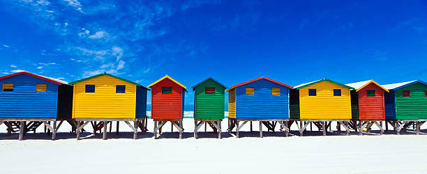 Beach Huts Brightly painted beach huts in Muizenberg Cape Town, South Africa beach hut stock pictures, royalty-free photos & images