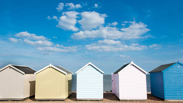 Beach Huts Row of six beach Huts at Felixstowe, Suffolk, UK. beach hut stock pictures, royalty-free photos & images