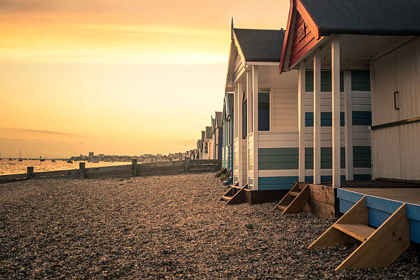 beach huts beach huts in southend on sea beach hut stock pictures, royalty-free photos & images