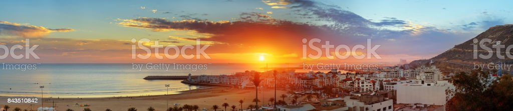 Beach in Agadir city at sunset, Morocco stock photo