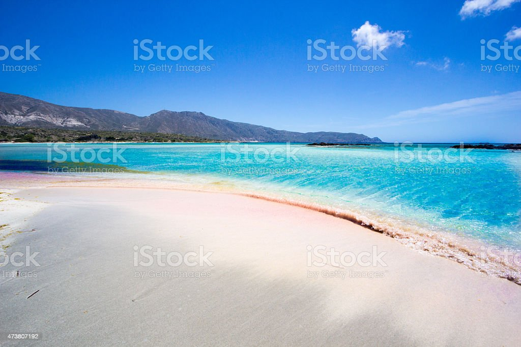 A beach in Crete, Greece with crystal clear blue water stock photo