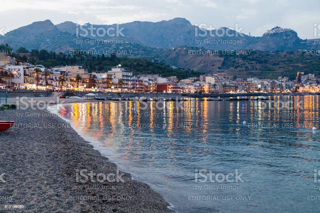 beach in Giardini Naxos city in summer evening stock photo
