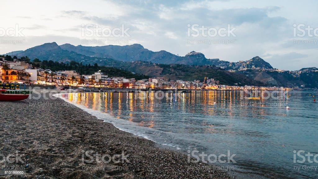 beach in Giardini Naxos town in summer evening stock photo
