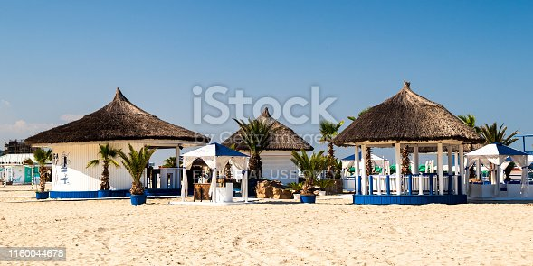 Mamaia, Constanta, Romania - june 18 2019: Beach in Mamaia, Constanta, popular tourist place and resort on black sea in a Romania. Cafe on a beach.