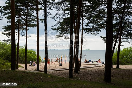Tallinn, Estonia - July 28, 2015: People exercise and relax at the beach in Pirita, Tallinn, Estonia