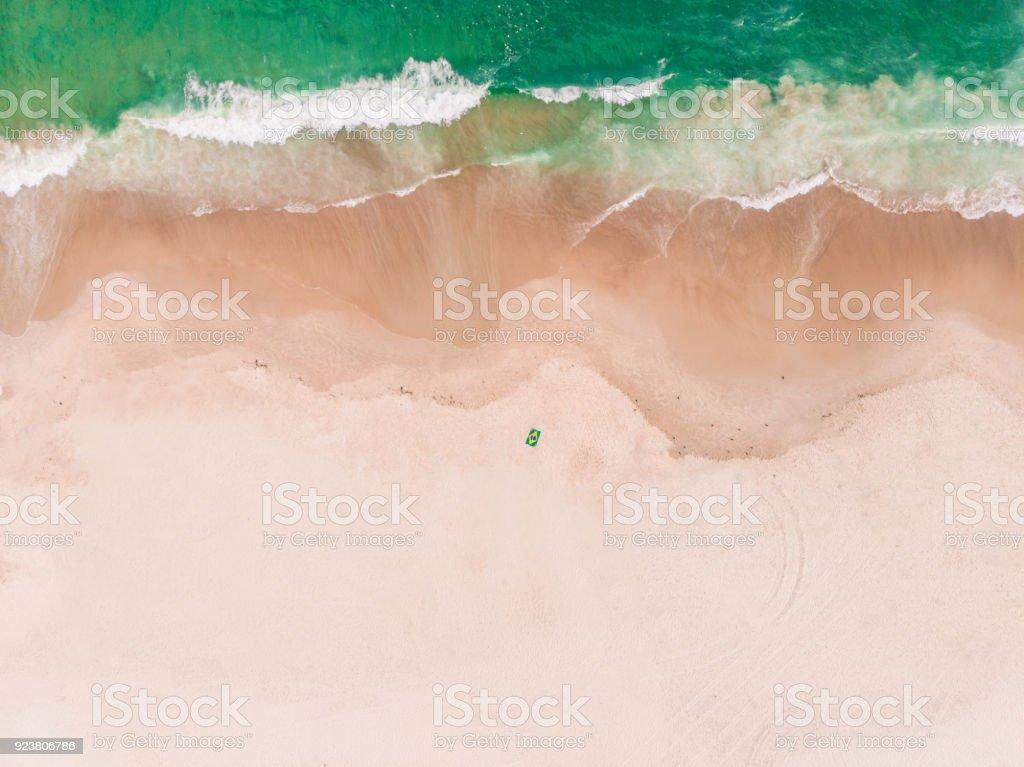 Beach in Rio de Janeiro, Brazil with Flag Towel stock photo