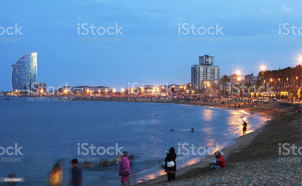 Beach in summer evening in Barcelona stock photo