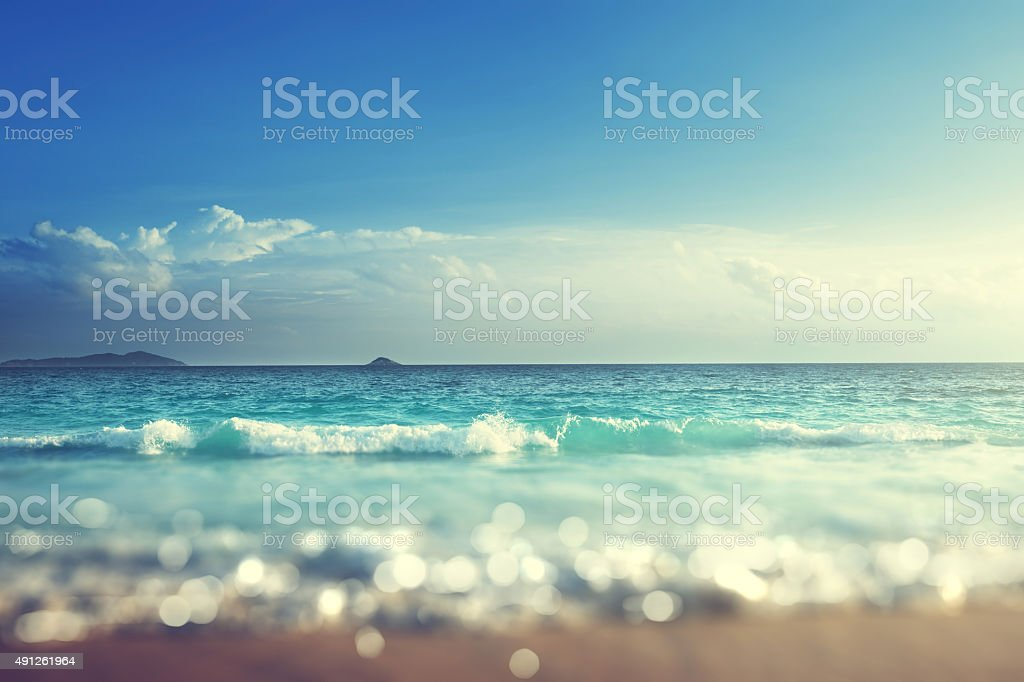 beach in sunset time, tilt shift soft effect stock photo