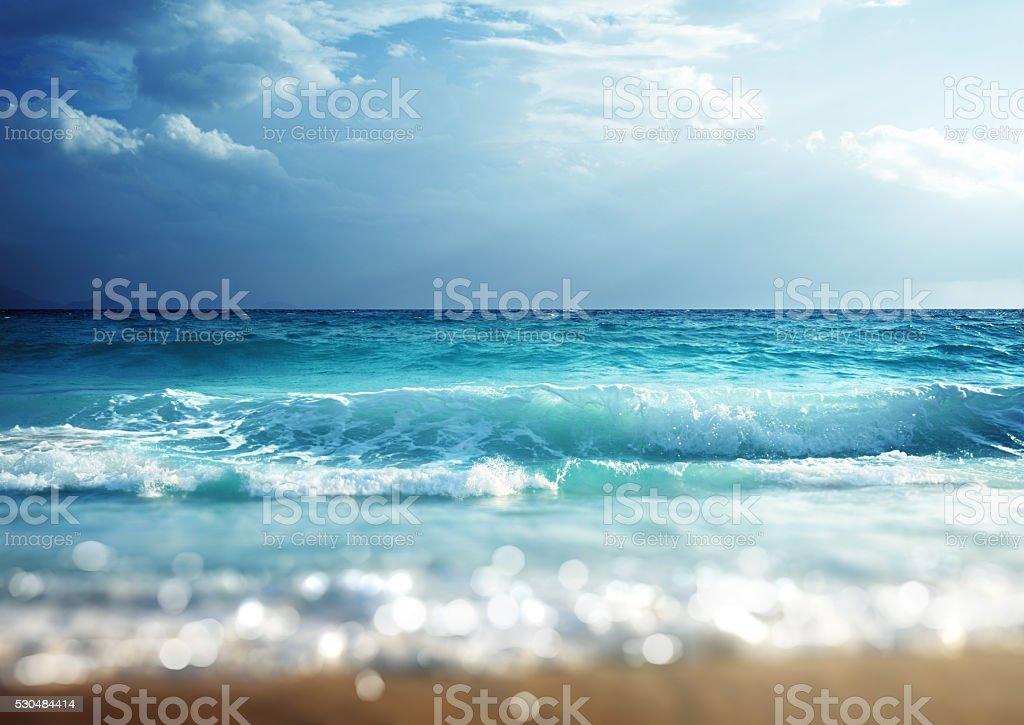 beach in sunset time, tilt shift soft effect stock photo