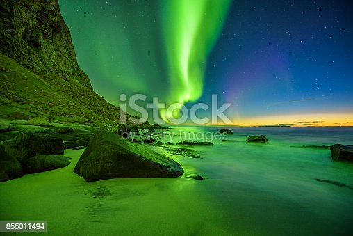 istock Beach in the Lofoten islands in Norway with strong green northern lights 855011494