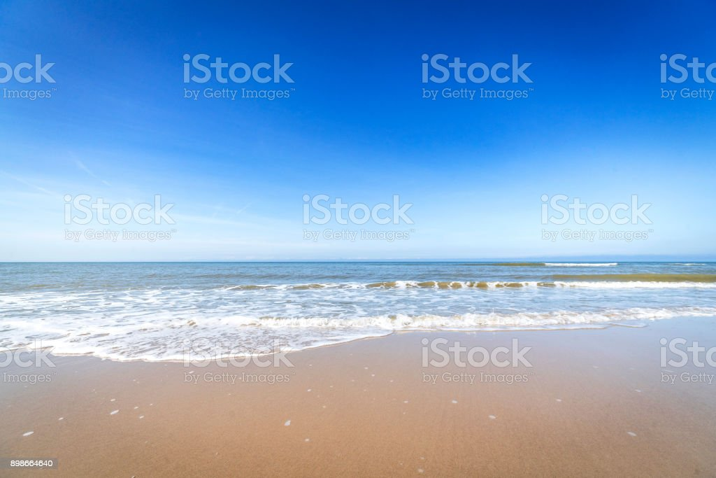 Beach in the summer with water coming in stock photo