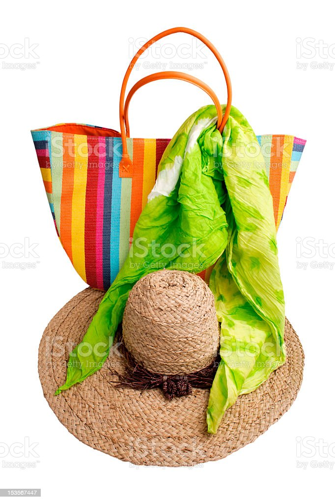 Beach items: colorful striped bag, straw hat and green kerchief royalty-free stock photo