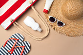 istock Beach items on beige paper background. Summer vacation concept 1294880336