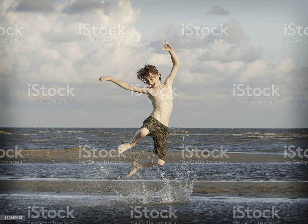 Beach Joyful Jump royalty-free stock photo