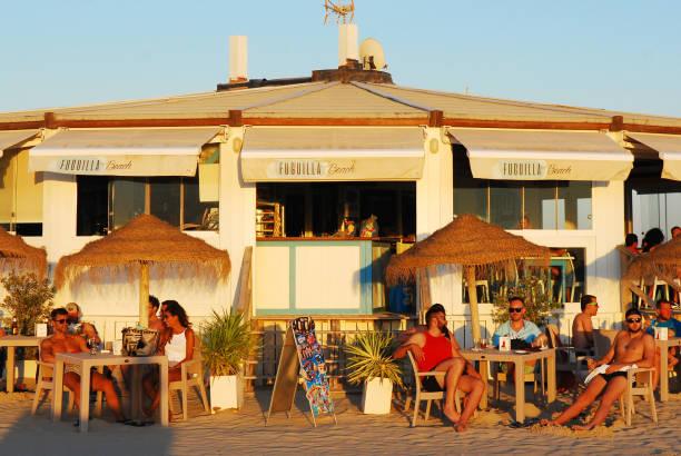 Beach Kiosk at Sunset in Conil de la Frontera Playa. stock photo