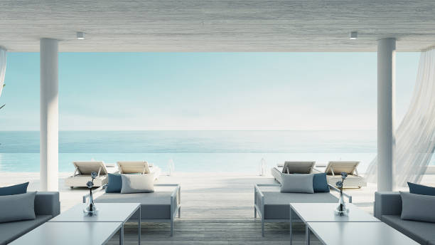 Beach living lounge - ocean villa seaside & sea view for vacation and summer / 3d render interior Beach living lounge - ocean villa seaside & sea view for vacation and summer / 3d render interior infinity pool stock pictures, royalty-free photos & images