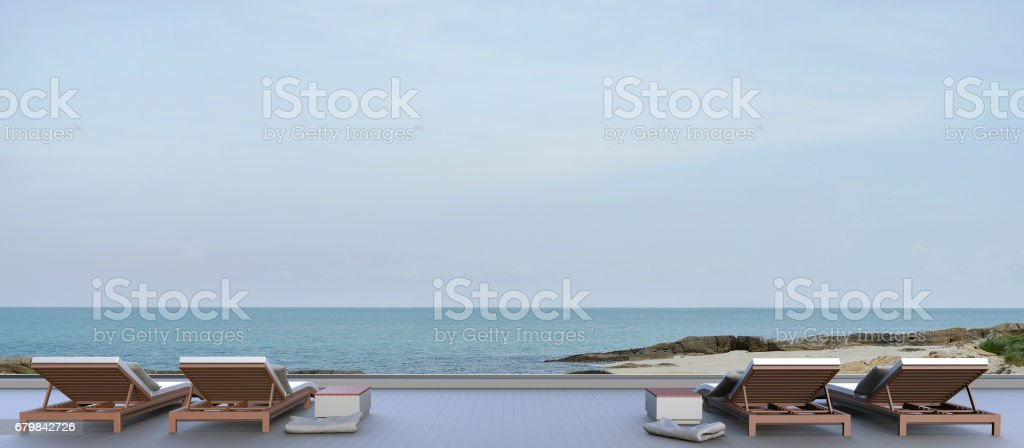 Beach lounge and Chaise outdoor and Sundeck on Sea view stock photo
