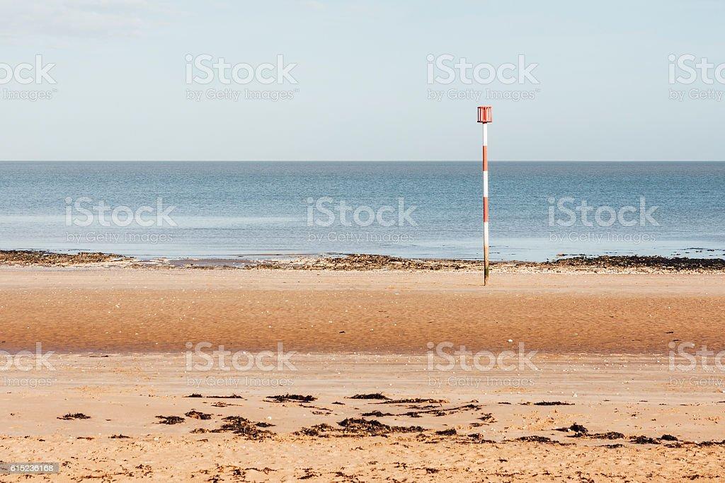 Beach marker on a beach near Margate in Kent stock photo
