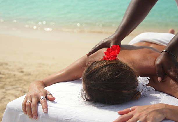 beach massage stock photo