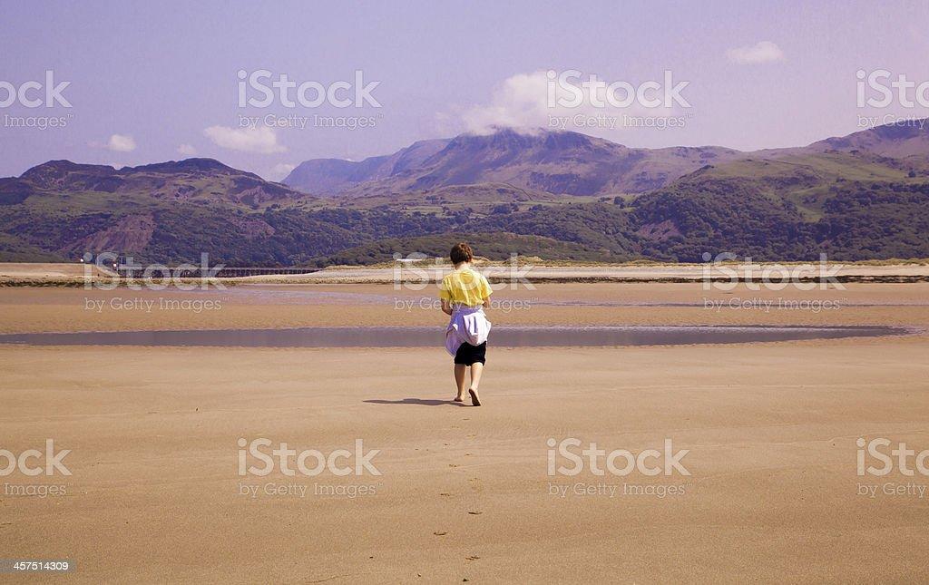 Beach, Mountains and Boy royalty-free stock photo