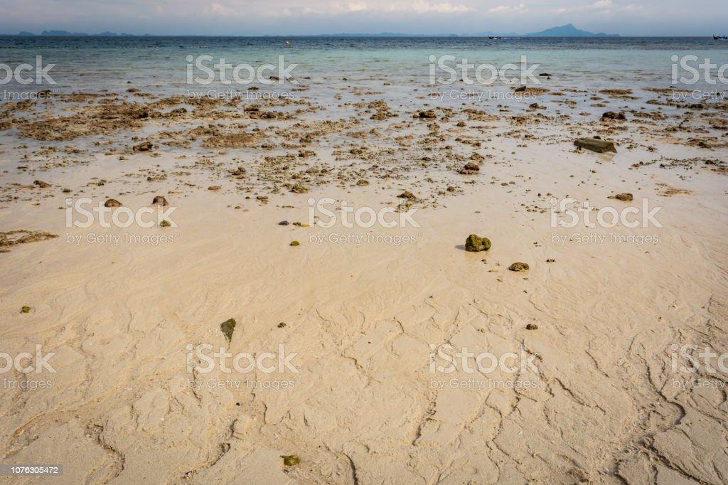 Beach near Krabi, Thailand, sunny beach, rocks, sand, azure water, sea, islands in the background – zdjęcie